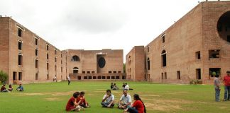 Students sitting in the campus lawns | Facebook