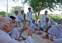 village elders sitting together