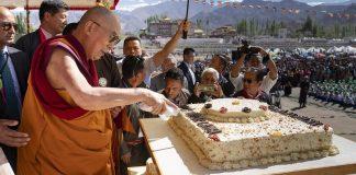 His Holiness cutting the cake in Leh   Tenzin Choejor/dalailama.com