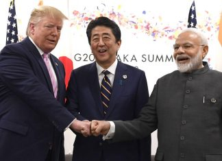 US President Donald Trump, left, Shinzo Abe, Japan's prime minister, center, and Narendra Modi at G-20 summit in Osaka   Photo: Carl Court/Pool via Bloomberg
