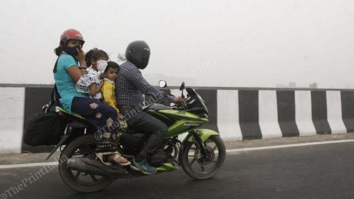 A family travels through the smog on the outskirts of Delhi on 3 November | Praveen Jain | ThePrint