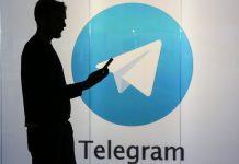 Representational Image | A man standing against an illuminated wall bearing Telegram's logo in London | Photo: Chris Ratcliffe | Bloomberg