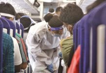 An air hostess wearing a PPE kit gives safety advisory to the passengers | Photo: Praveen Jain | ThePrint