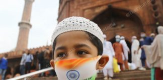 A boy wears a face mask with the Indian flag on it, at Delhi's Jama Masjid | Suraj Singh Bisht | ThePrint