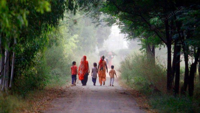 Young children accompany their mothers on a stroll in Chunni Kalan village of Mohali, Punjab | Praveen Jain | ThePrint
