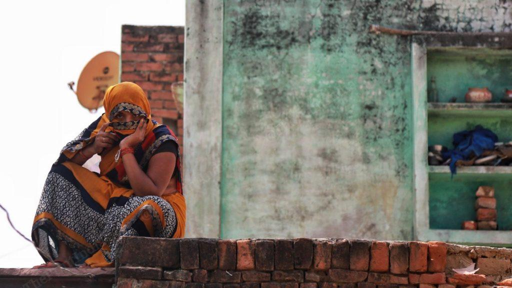 A relative of Hathras gang-rape and murder accused Sandeep Thakur sits on the terrace of her house in Boolgarhi village, Hathras | Photo: Manisha Mondal | ThePrint