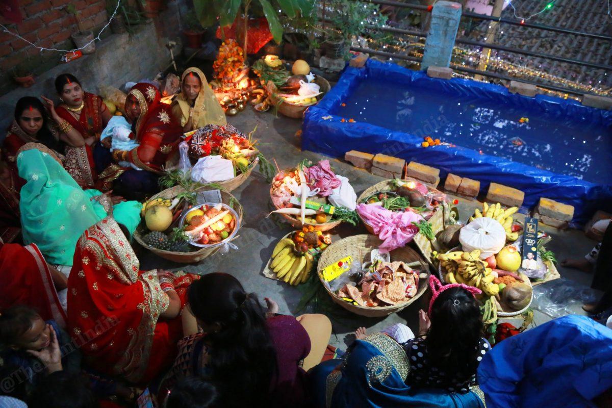 Women sit on a terrace after finishing puja | Photo: Manisha Mondal | ThePrint