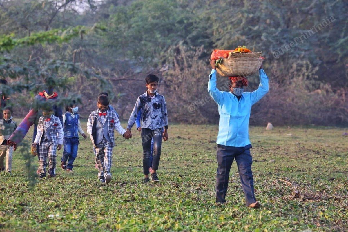 People sneakily cross the field | Photo: Praveen Jain | ThePrint