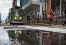 Commuters get off a tram at a station in Sapporo, Hokkaido, Japan on 5 November | Photo: Kentaro Takahashi | Bloomberg