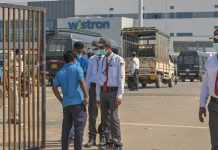 Security personnel stand outside Wistron Manufacturing at Narasapura area in Bengaluru | PTI File Photo