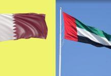 Flags of Qatar (L) and UAE