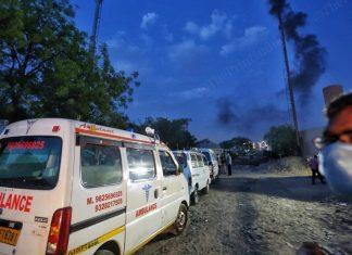 Ambulances queue up outside outside the Juna vadaj crematorium as chimneys bellow smoke | Photo: Praveen Jain | ThePrint
