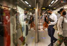 Commuters board a train at Waterloo London Underground station in London, on 19 July 2021   Hollie Adams   Bloomberg