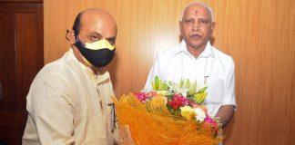 Basavaraj Bommai (left) with outgoing chief minister B.S. Yediyurappa | Twitter: @BSBommai