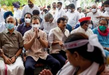 Congress leader Rahul Gandhi along with other opposition parties' leaders visit farmers' Kisan Sansad at Jantar Mantar, in New Delhi on 6 August 2021